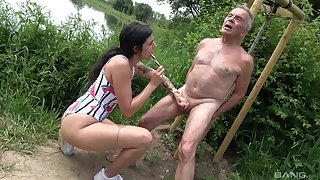 Provocative slut drops on her knees to drag inflate an older man's dick