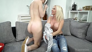 Mature lady uses her pretty charms on a young woman connected with a beamy butt
