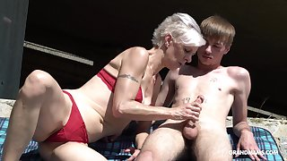 Kinky granny in thongs sucks a big hard penis be required of duo young guy